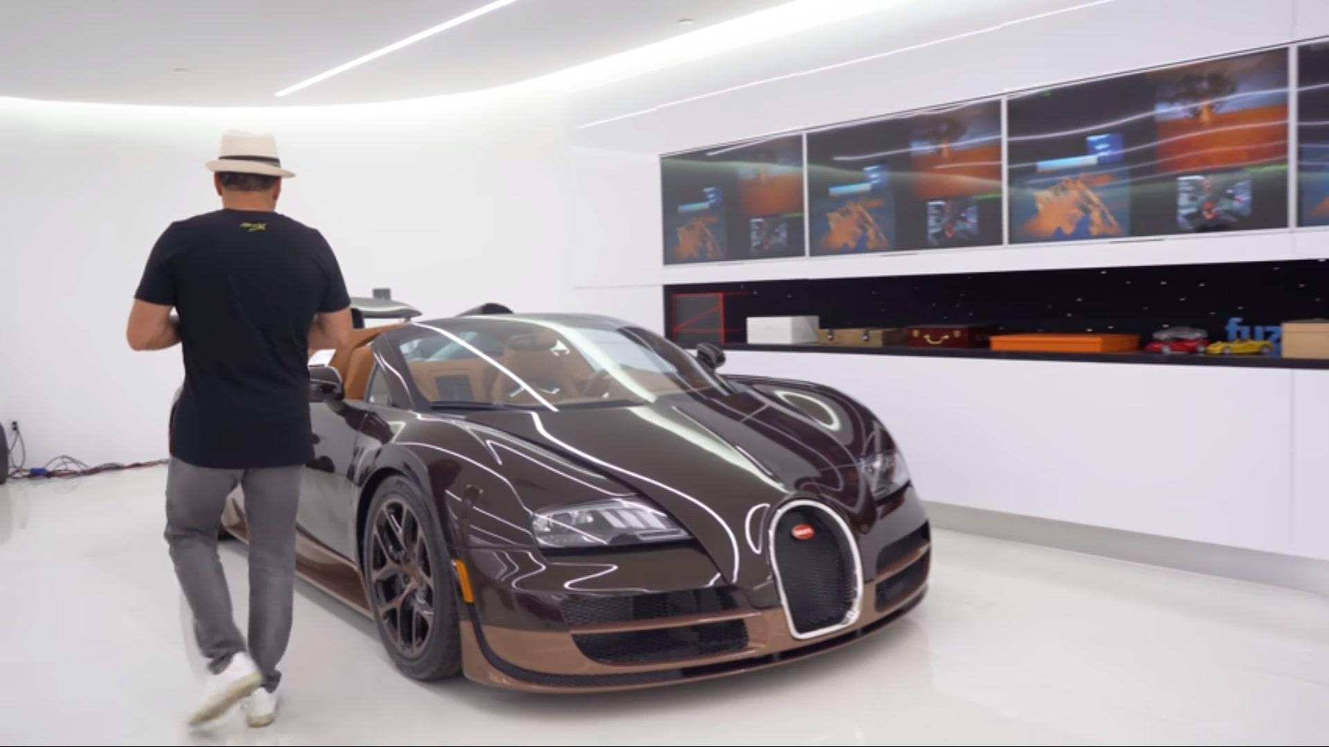 Miljonair geeft rondleiding in zijn garage / Bugatti Veyron Mansory