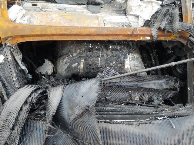 Porsche 911 Singer met brandschade