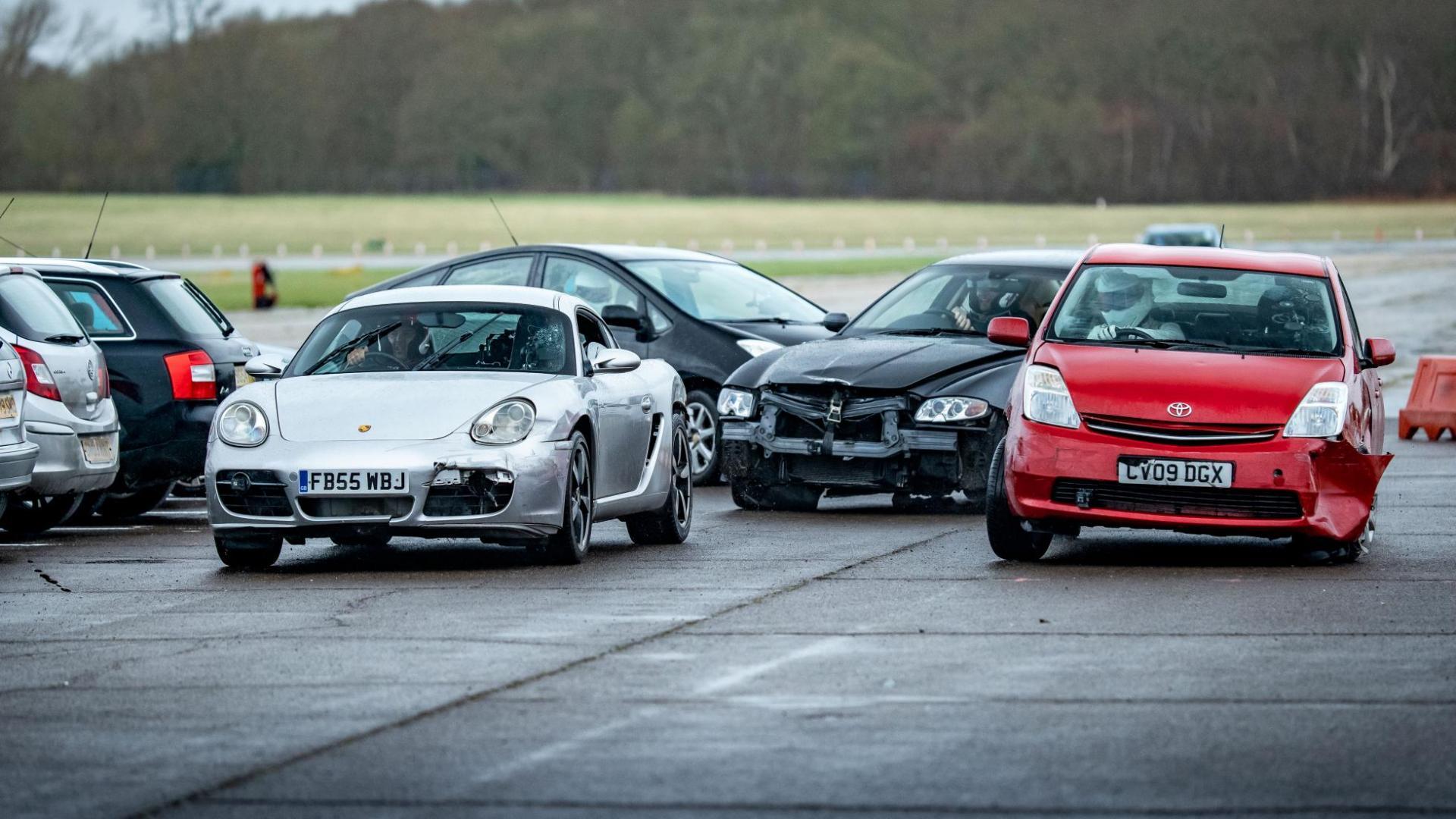 Toyota Prius Ford Focus ST MK1, Porsche Cayman, Maserati Quattroporte met schade