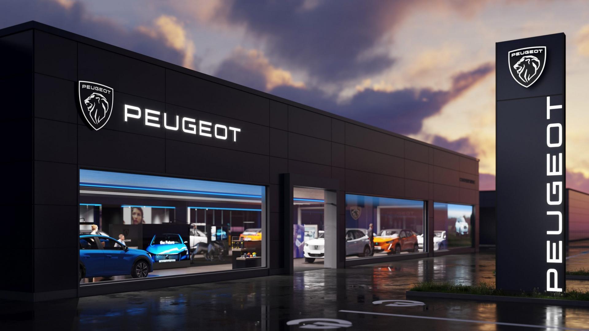 Peugeot-logo 2021 bij dealer in de nacht