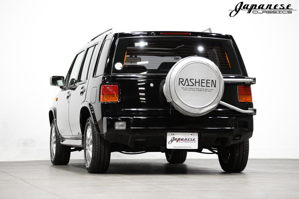 Achterkant Nissan Rasheen (Hummer ombouw)