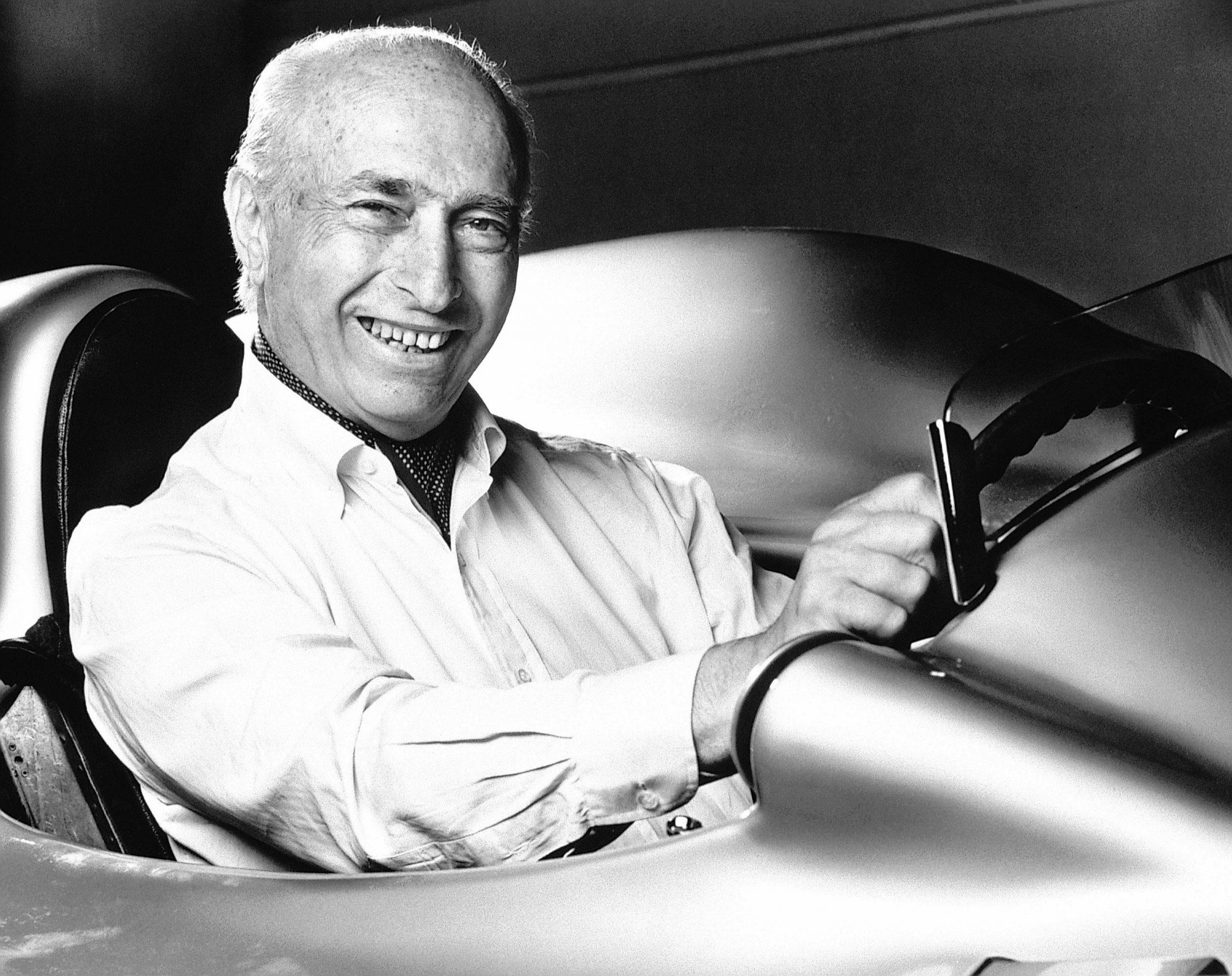 Juan Manuel Fangio achter stuur