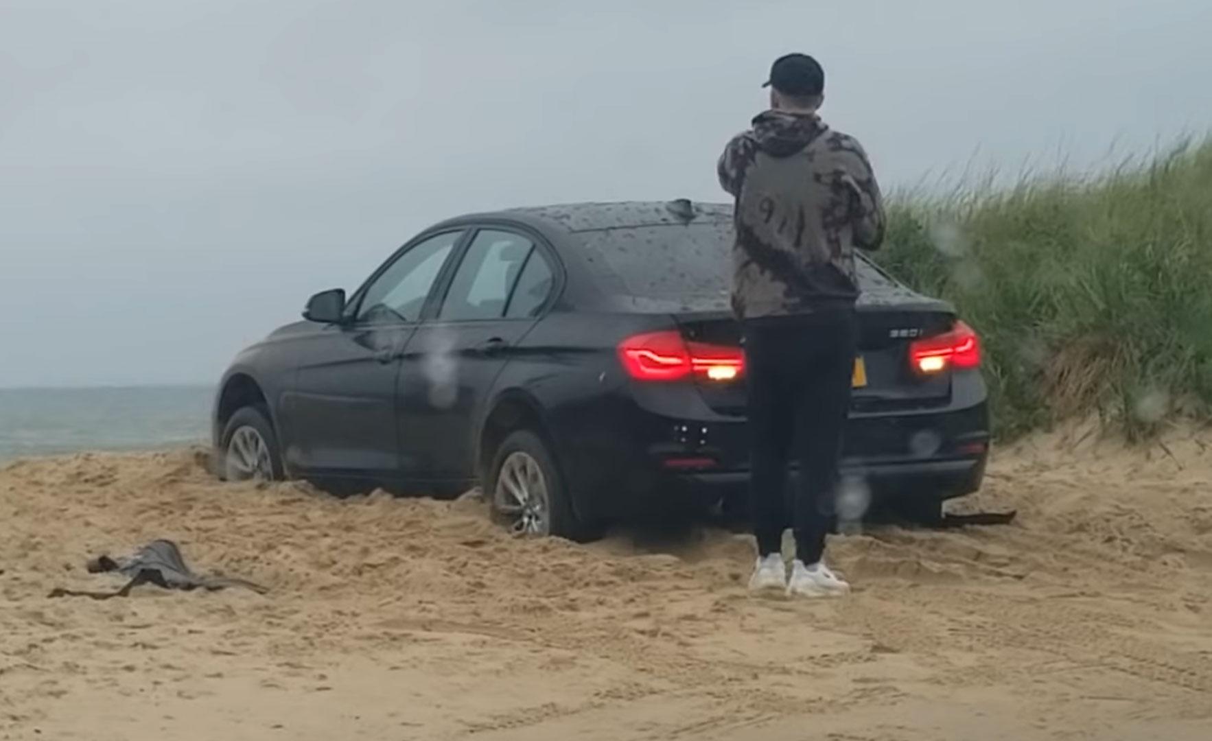BMW-rijder sluit zichzelf buiten, auto graaft zich in